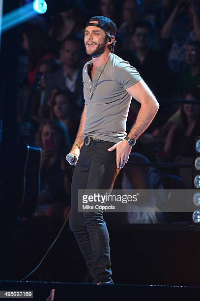 Thomas Rhett performs onstage during the 2014 CMT Music awards at the Bridgestone Arena on June 4 2014 in Nashville Tennessee