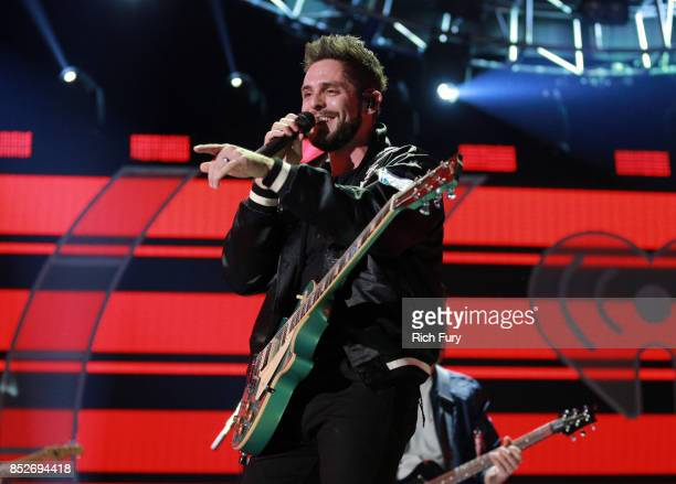 Thomas Rhett performs onstage during the 2017 iHeartRadio Music Festival at TMobile Arena on September 23 2017 in Las Vegas Nevada