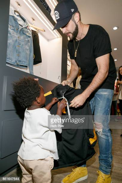 Thomas Rhett shows his daughter Willa Gray some items as Thomas Rhett kicks off his weekend Los Angeles Pop Up Store on September 22 2017 in Los...