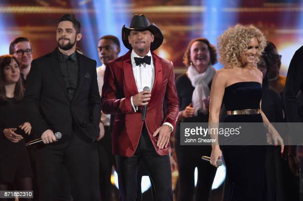 Thomas Rhett Tim McGraw and Kimberly Schlapman perform onstage at the 51st annual CMA Awards at the Bridgestone Arena on November 8 2017 in Nashville...