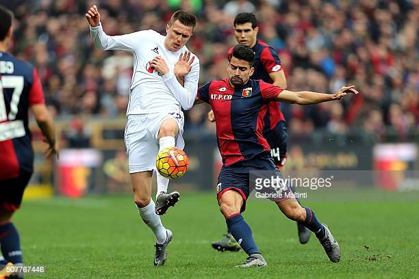 Thomas Rincon of Genoa CFC battles for the ball with Josip Ilicic of ACF Fiorentina during the Serie A match between Genoa CFC and ACF Fiorentina at...