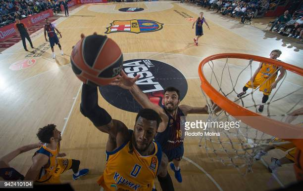 Thomas Robinson #0 of Khimki Moscow Region competes with Pierre Oriola #18 of FC Barcelona Lassa during the 2017/2018 Turkish Airlines EuroLeague...