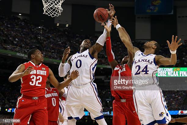Thomas Robinson and Travis Releford of the Kansas Jayhawks go up for the rebound against Deshaun Thomas in the first half during the National...
