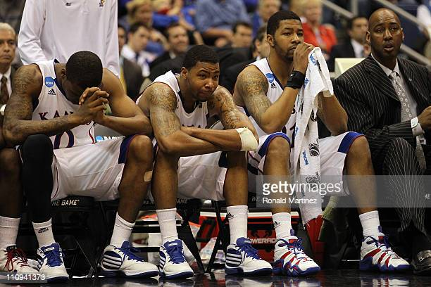 Thomas Robinson Marcus Morris Markieff Morris and assistant coach Danny Manning react during the southwest regional final of the 2011 NCAA men's...