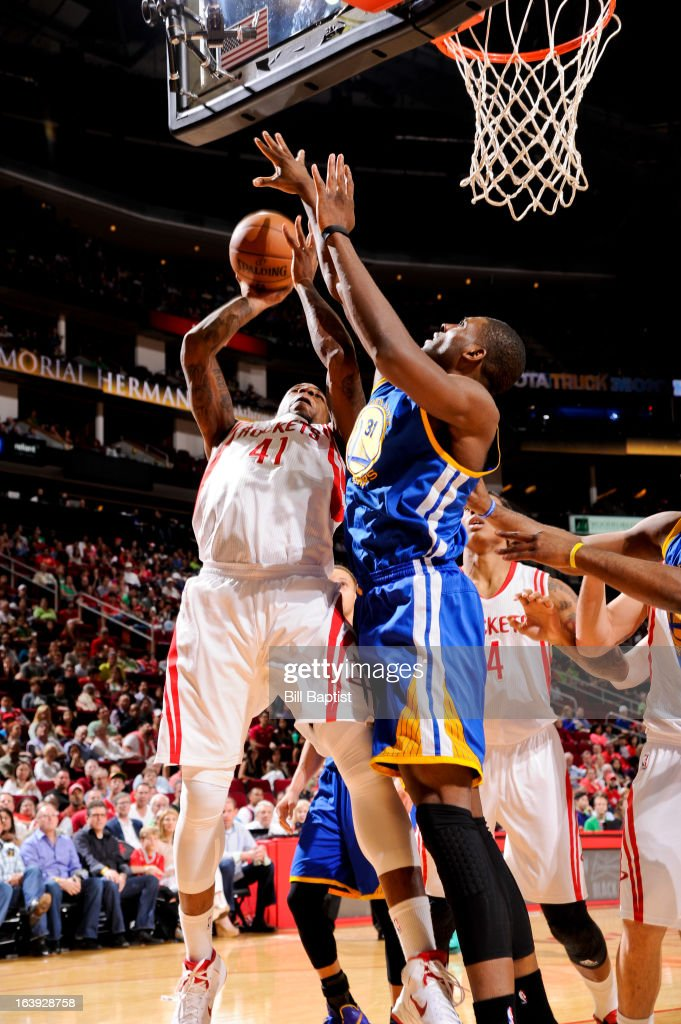 Thomas Robinson #41 of the Houston Rockets drives to the basket against Festus Ezeli #31 of the Golden State Warriors on March 17, 2013 at the Toyota Center in Houston, Texas.