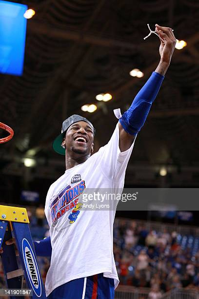 Thomas Robinson of the Kansas Jayhawks celebrates after cutting down a piece of the net after winning 80-67 against the North Carolina Tar Heels...