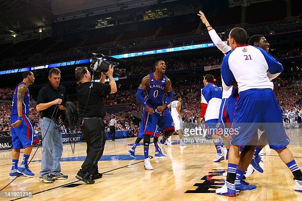Thomas Robinson of the Kansas Jayhawks celebrates with his teammates after they won 80-67 against the North Carolina Tar Heels during the 2012 NCAA...