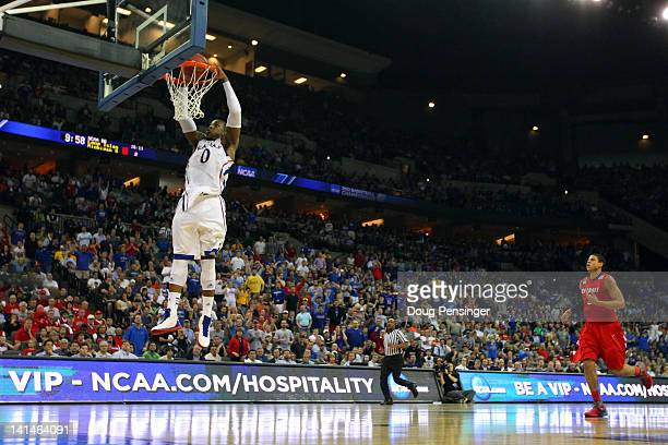 Thomas Robinson of the Kansas Jayhawks dunks in the first half against the Detroit Titans during the second round of the 2012 NCAA Men's Basketball...