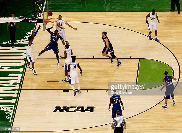 Thomas Robinson of the Kansas Jayhawks shoots over Terrence Jones of the Kentucky Wildcats in the first half in the National Championship Game of the...