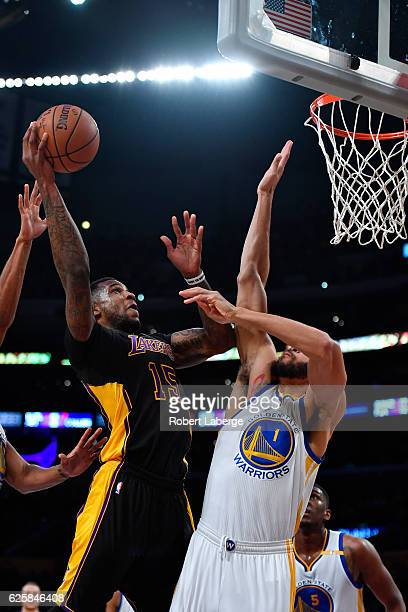 Thomas Robinson of the Los Angeles Lakers attempts a lay up against JaVale McGee of the Golden State Warriors on November 25 2016 at STAPLES Center...