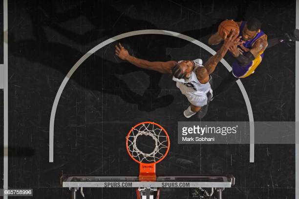 Thomas Robinson of the Los Angeles Lakers drives to the basket and get his shot blocked by Kawhi Leonard of the San Antonio Spurs on April 5 2017 at...