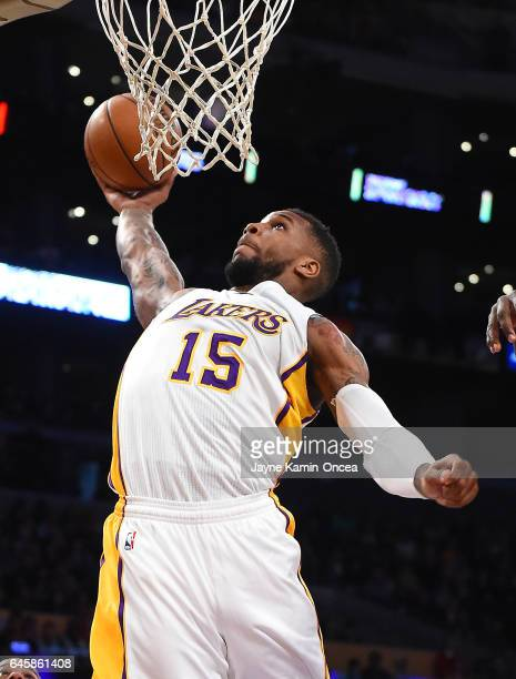 Thomas Robinson of the Los Angeles Lakers dunks during the game against the San Antonio Spurs at Staples Center on February 26 2017 in Los Angeles...