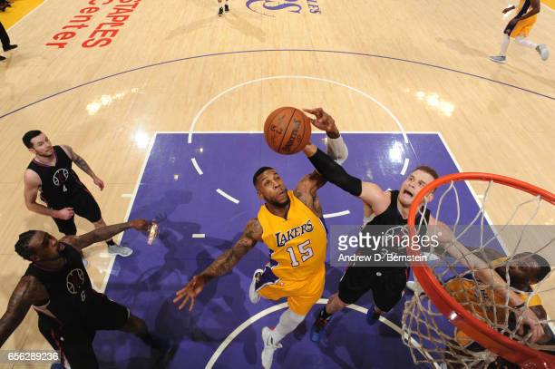 Thomas Robinson of the Los Angeles Lakers fights for a rebound against Blake Griffin of the LA Clippers during a game on March 21 2017 at STAPLES...