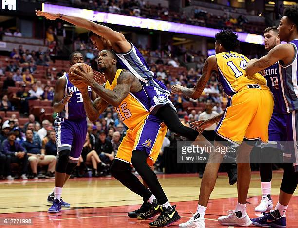 Thomas Robinson of the Los Angeles Lakers is fouled under the basket by Skal Labissiere of the Sacramento Kings during a preseason game at Honda...