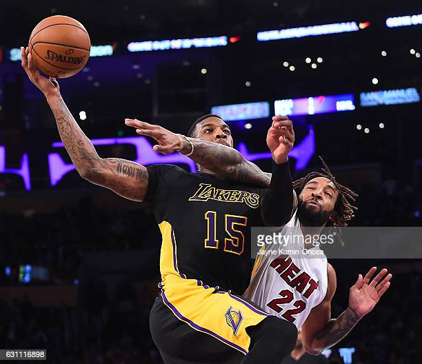 Thomas Robinson of the Los Angeles Lakers makes a shot past Derrick Williams of the Miami Heat in the second half of the game at Staples Center on...