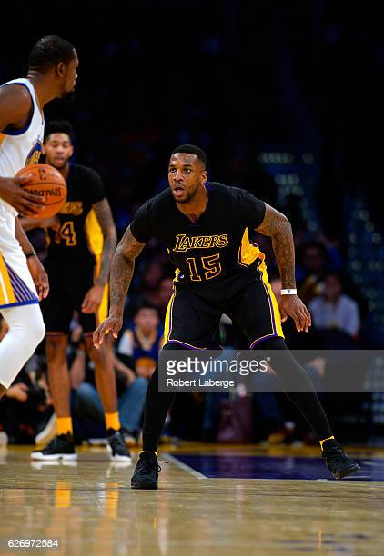 Thomas Robinson of the Los Angeles Lakers plays defense against Kevin Durant of the Golden State Warriors on November 25 2016 at STAPLES Center in...