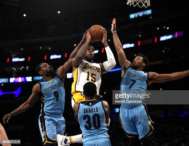 Thomas Robinson of the Los Angeles Lakers scores a basket in between Tony Allen Wayne Selden and Troy Daniels of the Memphis Grizzlies during the...