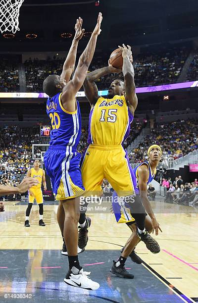 Thomas Robinson of the Los Angeles Lakers shoots against James Michael McAdoo of the Golden State Warriors during their preseason game at TMobile...