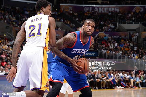 Thomas Robinson of the Philadelphia 76ers handles the ball against Ed Davis of the Los Angeles Lakers on March 22 2015 at Staples Center in Los...