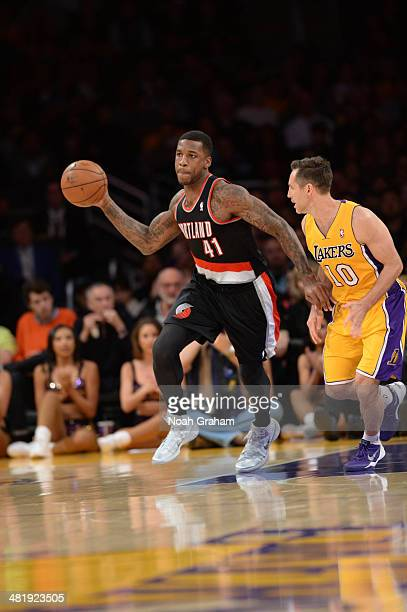Thomas Robinson of the Portland Trail Blazers passes against Steve Nash of the Los Angeles Lakers at Staples Center on April 1 2014 in Los Angeles...