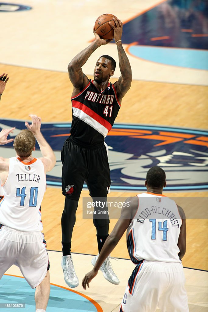 Thomas Robinson #41 of the Portland Trail Blazers takes a shot against the Charlotte Bobcats during the game at the Time Warner Cable Arena on March 22, 2014 in Charlotte, North Carolina.