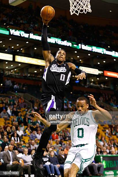 Thomas Robinson of the Sacramento Kings dunks over Avery Bradley of the Boston Celtics during the game on January 30 2013 at TD Garden in Boston...