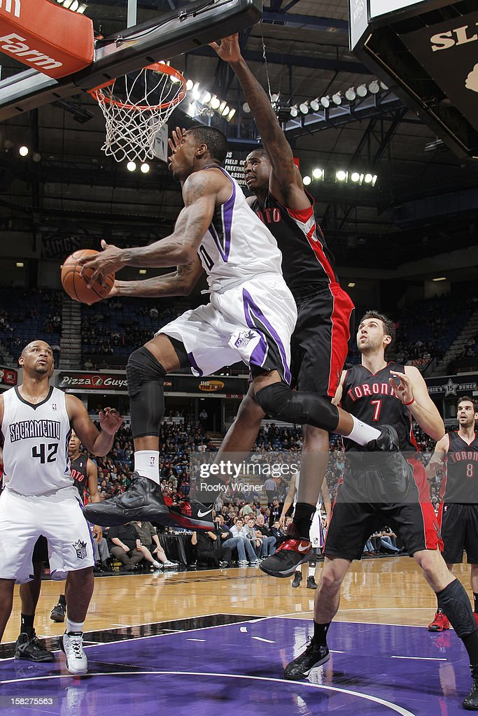 Thomas Robinson #0 of the Sacramento Kings goes up for the shot against Ed Davis #32 of the Toronto Raptors on December 5, 2012 at Sleep Train Arena in Sacramento, California.