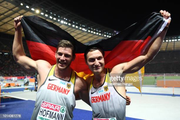 Thomas Roehler of Germany celebrates winning Gold with Andreas Hofmann of Germany who wins Silver in the Men's Javelin Throw Final during day three...