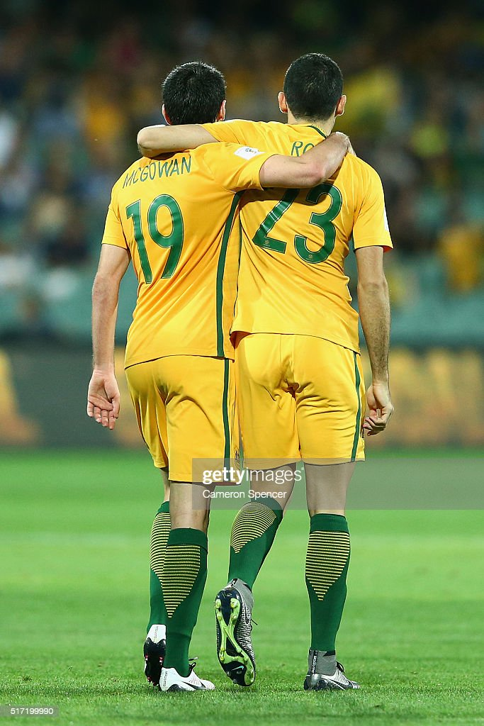 Thomas Rogic of Australia celebrates with Ryan McGowan of Australia after scoring a goal during the 2018 FIFA World Cup Qualification match between the Australia Socceroos and Tajikistan at the Adelaide Oval on March 24, 2016 in Adelaide, Australia.