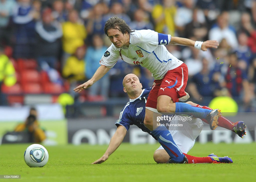 Thomas Rosicky of Czech Republic in action against Alan Hutton of Scotland during the UEFA EURO 2012 Group I Qualifying match between Scotland and Czech Republic at Hampden Park on September 03, 2011 in Glasgow, Scotland.