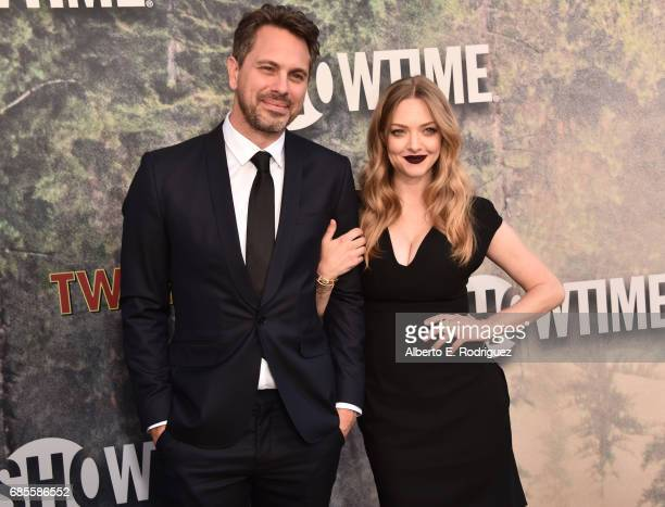 Thomas Sadoski and Amanda Seyfried attend the premiere of Showtime's Twin Peaks at The Theatre at Ace Hotel on May 19 2017 in Los Angeles California