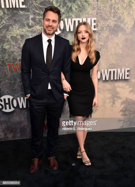 Thomas Sadoski and Amanda Seyfried attend the premiere of Showtime's 'Twin Peaks' at The Theatre at Ace Hotel on May 19 2017 in Los Angeles California