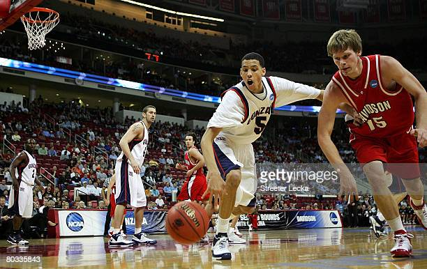 Thomas Sander of the Davidson Wildcats dives for a loose ball with Austin Daye of the Gonzaga Bulldogs during the 1st round of the 2008 NCAA Men's...