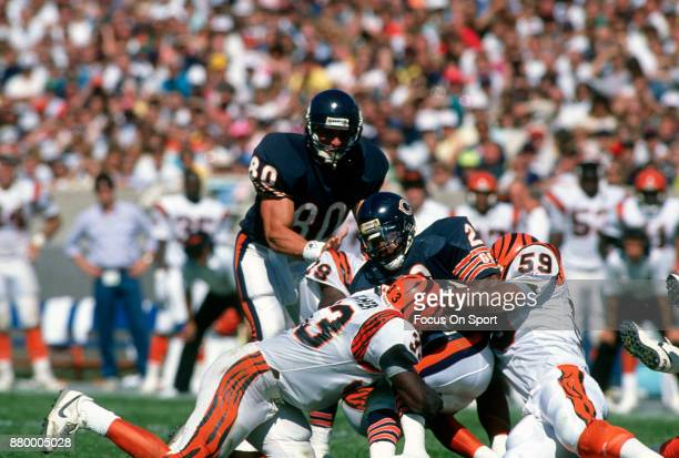 Thomas Sanders of the Chicago Bears gets tackled by David Fulcher and Kevin Walker of the Cincinnati Bengals during an NFL football game September 10...