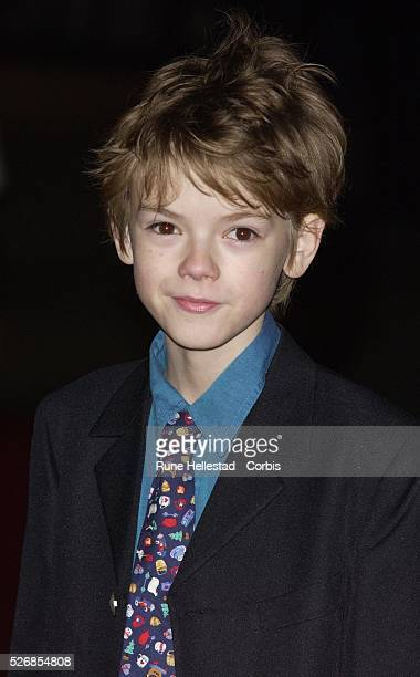 "Thomas Sangster attends the premiere of ""Love Actually"" at the Odeon, Leicester Square."