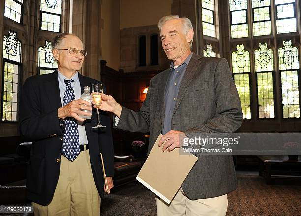Thomas Sargent, a New York University economist who is a visiting professor at Princeton and Princeton University professor Christopher Sims toast at...