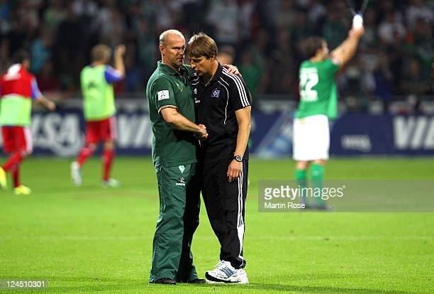 Thomas Schaaf head coach of Bremen comforts Michael Oenning head coach of Hamburg after the Bundesliga match between Werder Bremen and Hamburger SV...