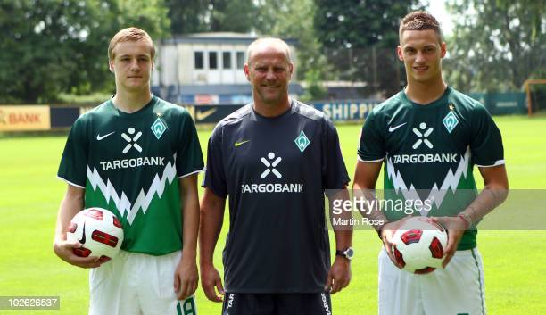 Thomas Schaaf head coach of Bremen poses with new player Felix Kroos and Marko Arnautovic prior to the Werder Bremen first training session for the...