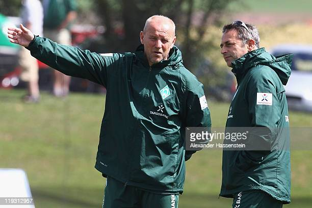 Thomas Schaaf head coach of Bremen talks to Bremen's manager Klaus Allofs during the Werder Bremen training session on July 18 2011 in Donaueschingen...