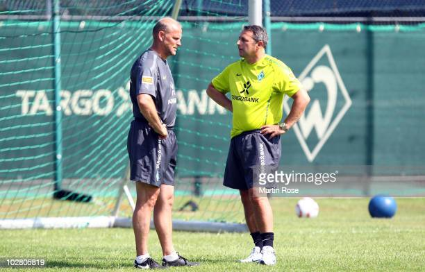 Thomas Schaaf head coach of Bremen talks to Klaus Allofs manager of Bremen during the Werder Bremen training session on training ground 'An der...