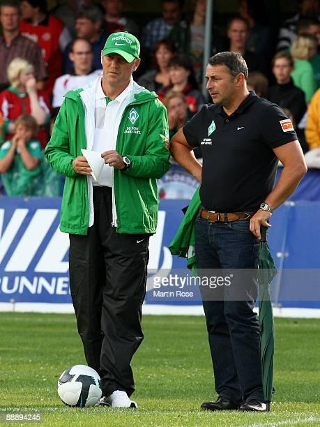 Thomas Schaaf head coach of Bremen talks to manager Klaus Allofs prior to the pre season friendly match between RotWeiss Essen and Werder Bremen at...