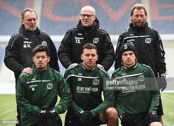 Thomas Schaaf head coach of Hannover 96 poses for a photograph with new signings Hotaru Yamaguchi Ádám Szalai and Iver Fossum during his first...