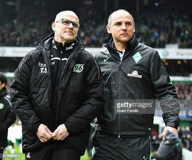 Thomas Schaaf head coach of Hannover walks out with Viktor Skripnik head coach of Bremen during the Bundesliga match between Werder Bremen and...