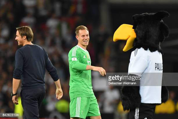 Thomas Schneider assistant national coach of Germany MarcAndre ter Stegen of Germany and the German mascot celebrate after the FIFA 2018 World Cup...