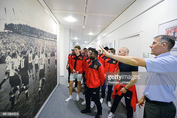 Thomas Schnellker shows the English football team Sheffield FC from South Yorkshire a picture of the celebrating German Team when the they won the...