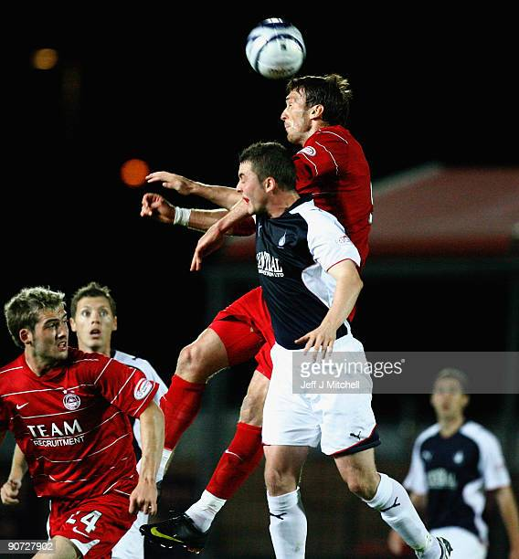 Thomas Scobbie of Falkirk tackles Lee Miller of Aberdeen during the Clydesdale Bank Scottish Premier league match between Falkirk and Aberdeen at...