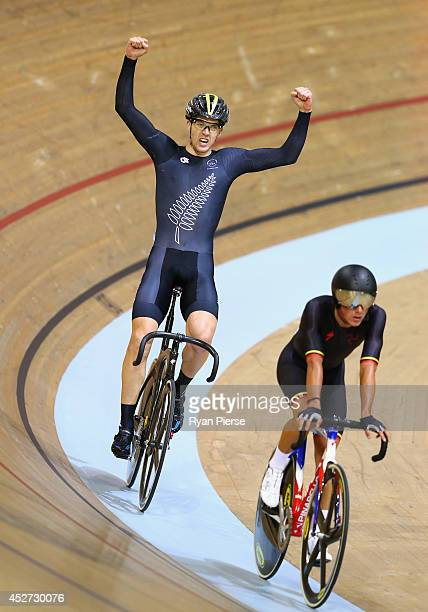 Thomas Scully of New Zealand celebrates after winning Gold in the Men's 40km Points Race at Sir Chris Hoy Velodrome during day three of the Glasgow...