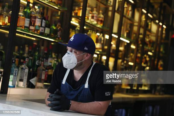 Thomas Sheppard the bartender waits for drink orders at the KYU restaurant in Wynwood on July 09 2020 in Miami Florida The restaurant created an...