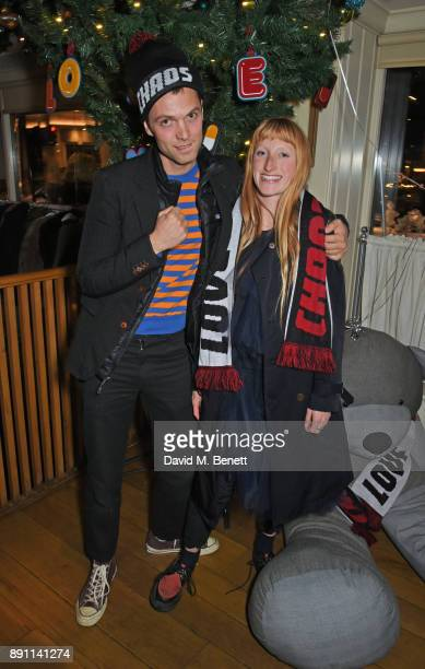 Thomas Shickle and Molly Goddard attend the Love x Chaos x Poppy Delevingne x Moet Christmas Party at George on December 12 2017 in London England