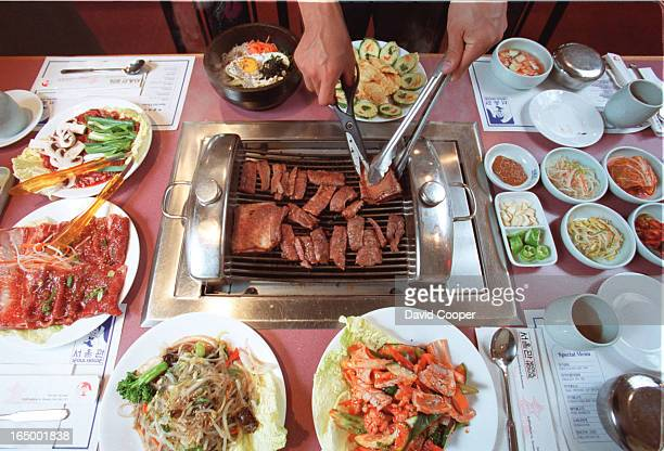 Thomas Shin prepares Kalbi BBQ on charcoal grill right at your table Then you place a small portion of beef on a lettuce leaf with veggies sauce and...
